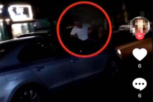 坐行车引擎盖上拍视频嚣张挑衅 交警:安排上了