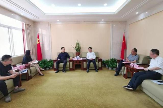 南昌市西湖区委书记梅茂发会见新浪江西总经理谌玺阳