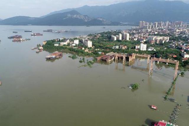 江西遭遇本世纪最大洪水 湖区所有单退圩堤开闸分洪