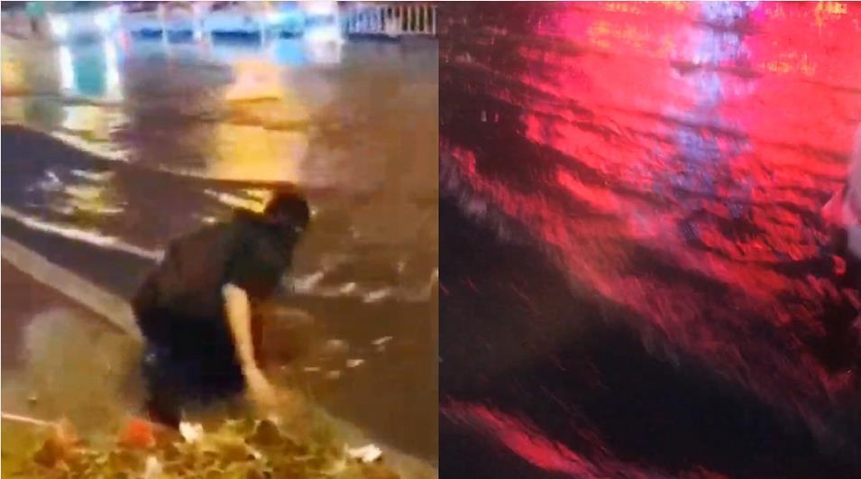 辽宁抚顺突降暴雨 15岁男孩跪地徒手清理排水口杂物