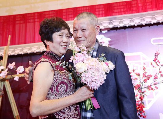 参加活动的王康尧夫妇 杨洋 摄