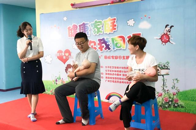 杭州江干区开展爸爸体验怀孕