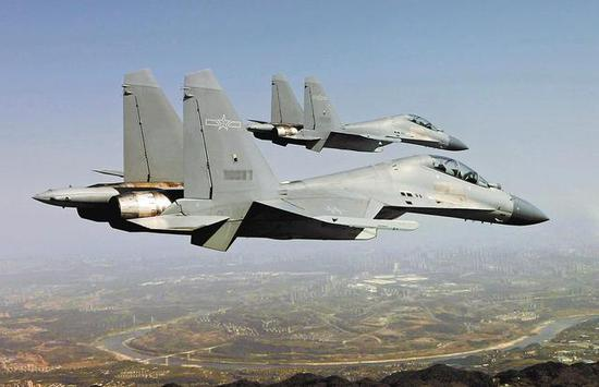图片:西部战区空军某旅的歼-16双机,中国军网英文站图片