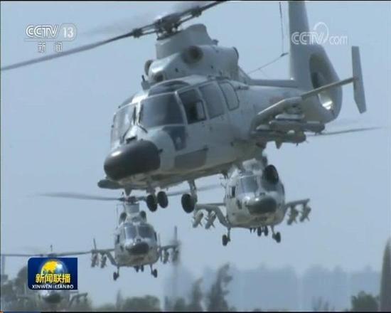 图为新闻报道中的直-9D直升机,挂载导弹为鹰击-9。