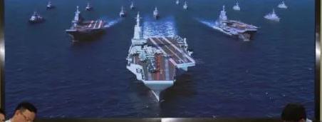 七〇一所会议室背景上的新型国产航母效果图 图片来源:中船重工官方微信