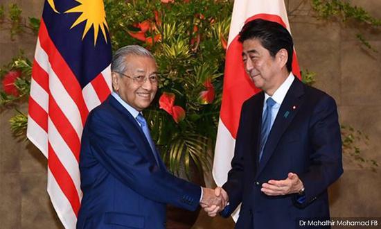 安倍与马来西亚总理谈南海:应让全球船只自由航行