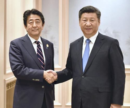 9月5日国度主席习近平会见日本宰衡安倍晋三