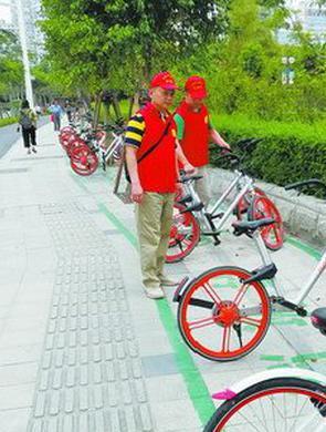 明起将清理4条示范道路共享单车违停