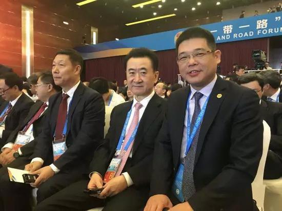 九牧董事长林孝发与万达集团董事长王健林合影