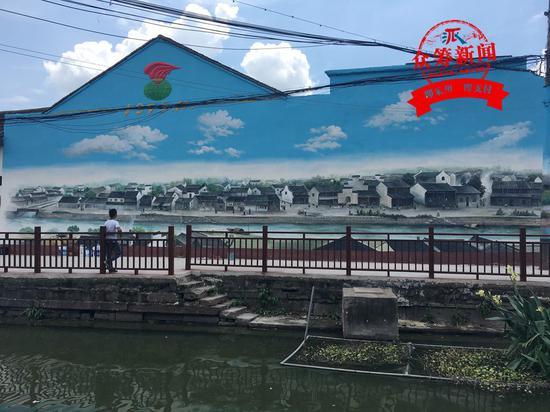 (以上均是陈锦良在姜山东新老街创作的墙绘)
