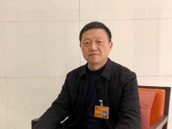 宁波市人民防空办公室主任、党组书记?#28010;?#25935;?#37038;?#20013;新网专访。项菁摄