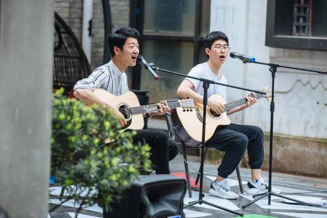 浙报点赞宁波老外滩 街头艺人持证上岗让城市更温暖
