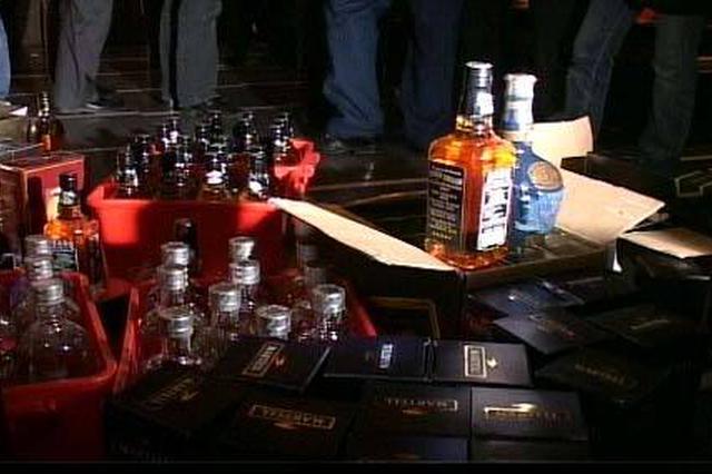 鄞州一娱乐会所售人头马、马爹利等假洋酒被罚20万