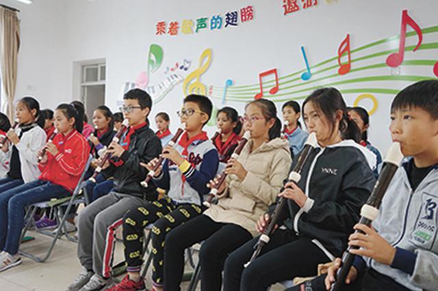 鄞州一所农村点校靠一支直笛奏响农村娃娃的音乐梦