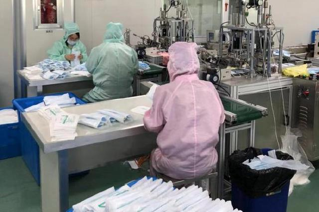 溪口医疗器械公司赶制医用口罩 日产十五万只