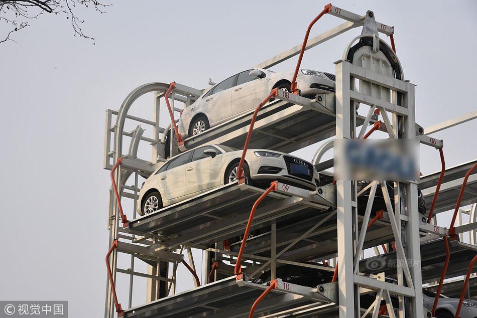 man lifting car