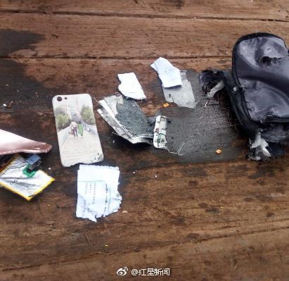 图3为现场打捞起的手机壳、背包、证件等