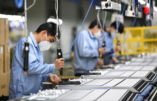 中国在防疫和复工平衡中维护全球供应链稳定图片