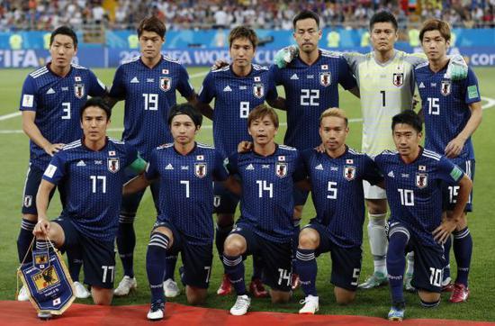 7月2日,日本队首发阵容在八分之一决赛前合影(新华社)
