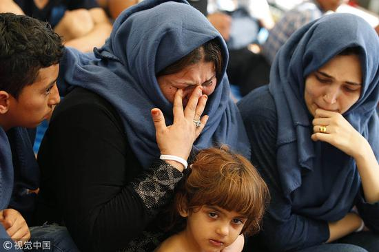 哭泣的利比亚难民@视觉中国