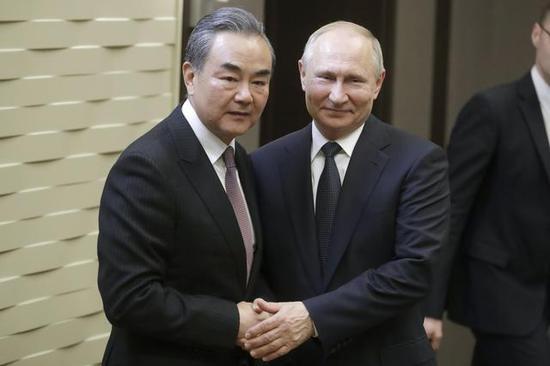 國務委員兼外長王毅與俄羅斯總統普京。