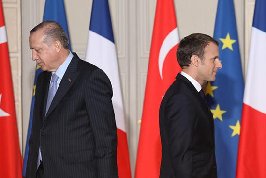 土耳其总统埃尔多安(左)和法国总统马克龙。