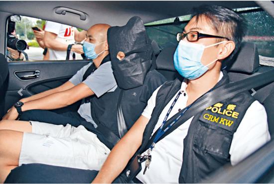"""内地游客遭黑衣人""""私了""""打至重伤,港警拘捕两人图片"""