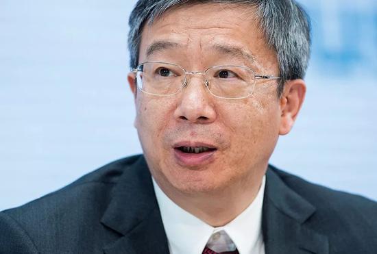 """(""""心情平静、庄重,使命神圣、光荣""""60岁的易纲以此形容接任中国人民银行行长的心情。图/AFP)"""