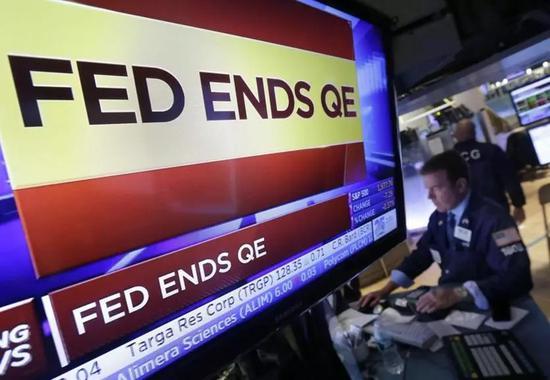 ▲資料圖片:2014年10月29日,美聯儲(FED)宣佈停止購買抵押貸款證券和美國國債,結束了第三輪量化寬鬆(QE)。(美聯社)
