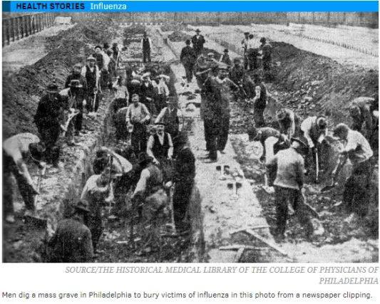大量志愿者在挖掘集体坟墓。