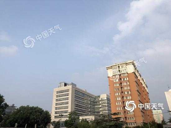 今晨,北京天朗氣清,氣溫舒適。(圖/王曉)