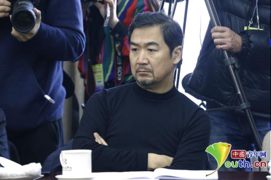全国政协委员、国家一级演员张国立。 中国青年网记者 李拓 摄