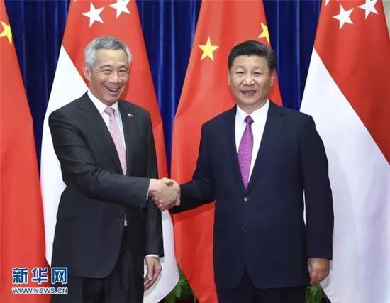 ▲9月20日,国度主席习近平在北京人口民大礼堂会晤来华举行正式会见之新加坡总理李显龙。新华社