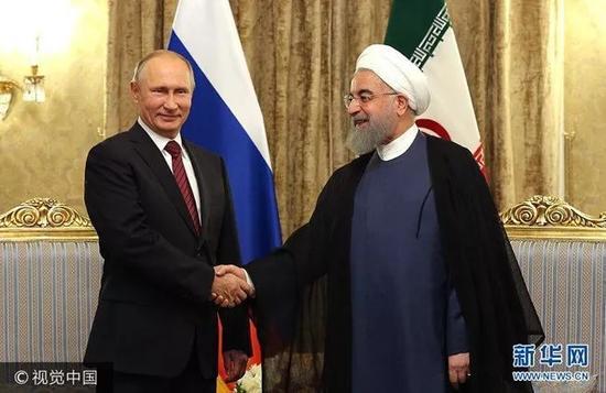 ▲11月1日,伊朗总统鲁哈尼会见了到访的俄罗斯总统普京。(视觉中国)