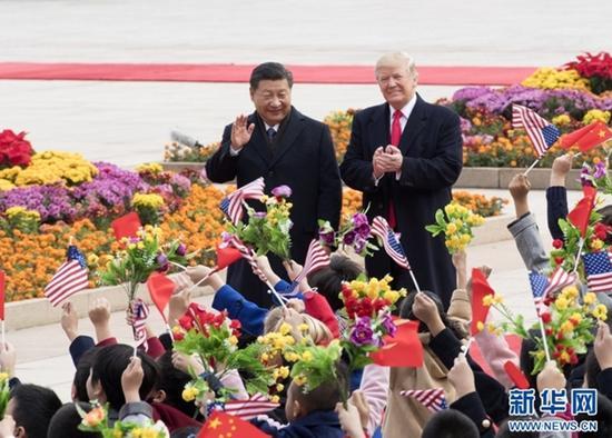 11月9日,国家主席习近平在北京人民大会堂东门外广场举行欢迎仪式,欢迎美利坚合众国总统唐纳德<span class=