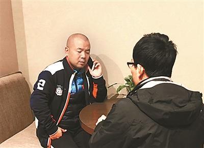 周建刚在北京接受北京青年报采访