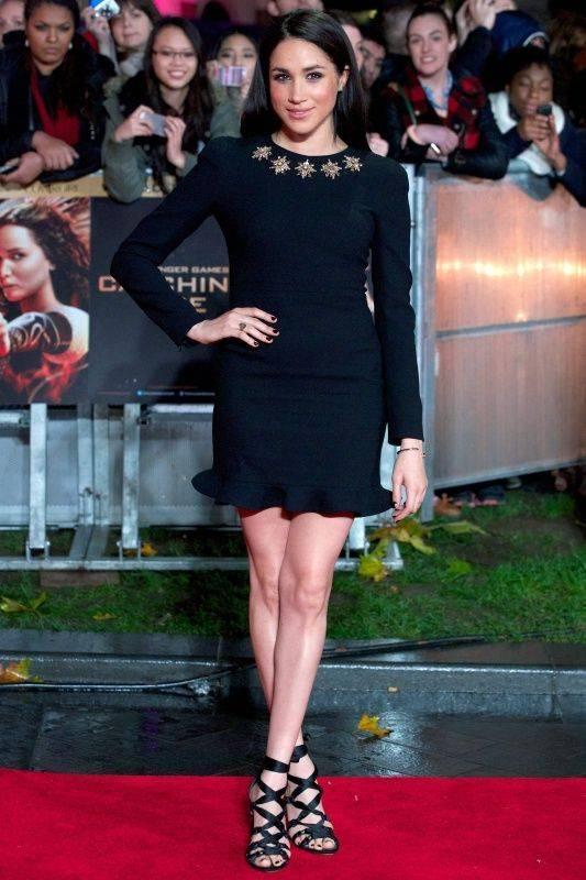 这是2013年11月11日在英国伦敦拍摄的梅根・马克尔出席电影《饥饿游戏2:星火燎原》首映式的资料照片。新华社/法新