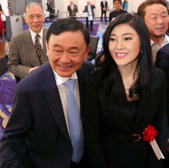 他信、英拉兄妹现身日本。(图片来源:泰国《民族报)