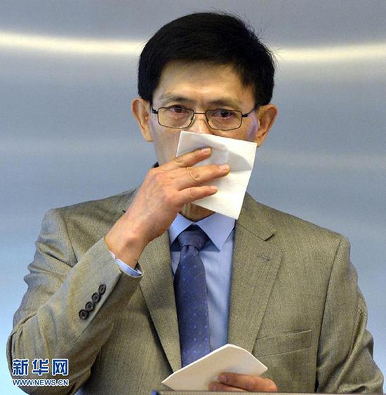 2015年9月15日,郗小星在发言时讲到动情处忍不住落泪。 新华网 资料图