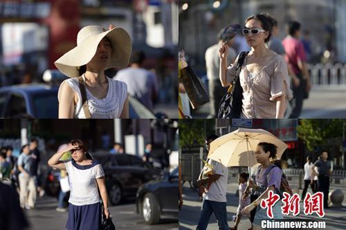 资料图:处暑暑难消,北京依旧高温。中新社发 刘文华 摄