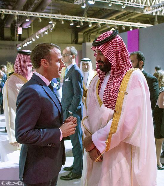 马克龙与沙特王储在峰会场边交谈 @视觉中国
