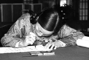1954年,出席第一届全国人代会的申纪兰在报到表上签字