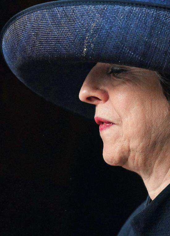 2017年3月13日,英國倫敦,英國首相特雷莎·梅出席聯邦日禮拜後離開威斯敏斯特教堂。 圖/ 視覺中國