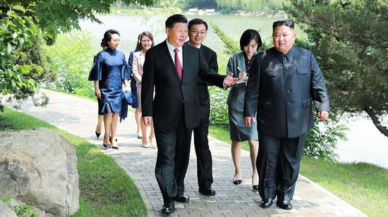 2019年6月21日,习近平在锦绣山迎宾馆会见朝鲜劳动党委员长、国务委员会委员长金正恩。