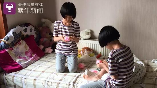 失独母亲生下双胞胎闺女8年:幸福正在被忧愁取代