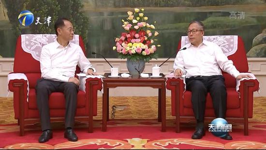 改判无罪一年后物美张文中坐到了天津市领导前面
