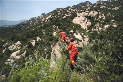 女子在北京凤凰岭失联 百人搜救七天仍未找到踪迹