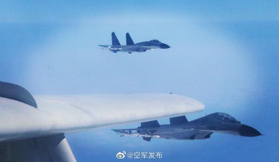 连续两日绕台后 空军发布歼11轰6K挂弹飞行画面图片