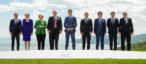 6月8日,在加拿大魁北克省夏尔瓦镇,(从左至右)欧洲理事会主席图斯克、英国首相特雷莎<span class=