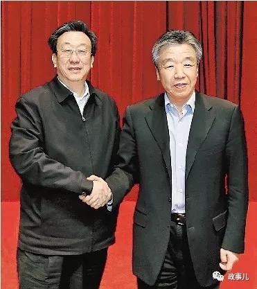 郭庚茂与卢展工(右)